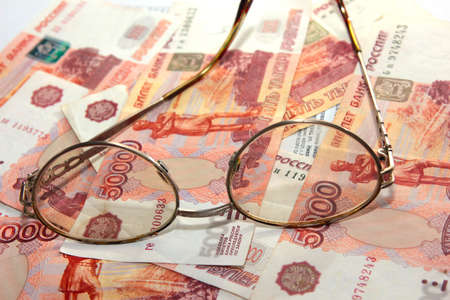 scene several thousand rouble and old spectacles for correcting the vision Stock Photo - 16366314