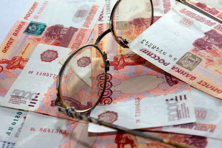 scene several thousand rouble and old spectacles for correcting the vision Stock Photo - 16366190