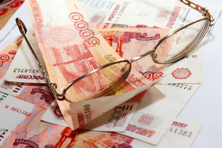 scene several thousand rouble and old spectacles for correcting the vision Stock Photo - 16366189