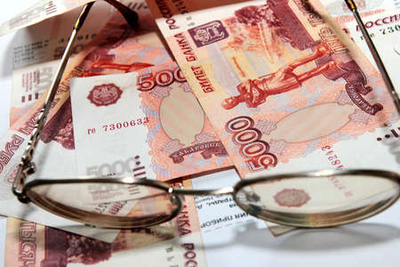 scene several thousand rouble and old spectacles for correcting the vision Stock Photo - 16366322