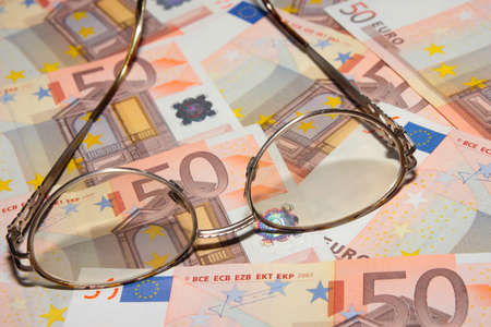 mount price: certain amount bill europe euro and old spectacles Stock Photo
