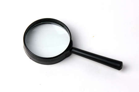 prospecting: scene magnifying glass as instrument for scientific prospecting Stock Photo