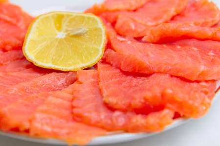 bit red fish salmon with lemon as delicacy meal Stock Photo - 17744974