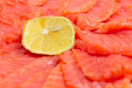 bit red fish salmon with lemon as delicacy meal Stock Photo - 17744976