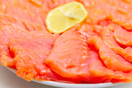 bit red fish salmon with lemon as delicacy meal photo