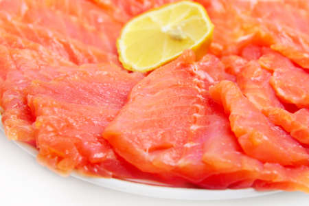 bit red fish salmon with lemon as delicacy meal Stock Photo - 17744981