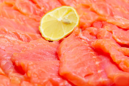 bit red fish salmon with lemon as delicacy meal Stock Photo - 17744978