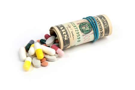 american paper currency and medical pill as pay medicine  Archivio Fotografico