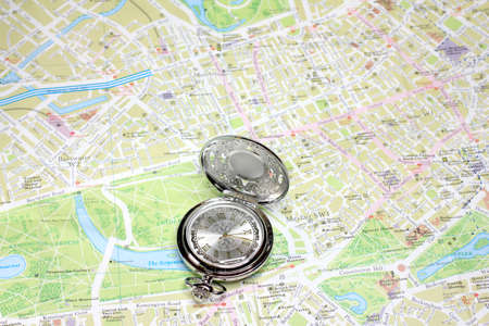 exact watch and geographical map as element choice directions journey photo