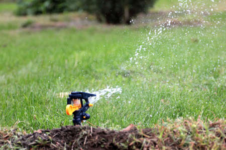 irrigation system moistening land for growing green lawn photo