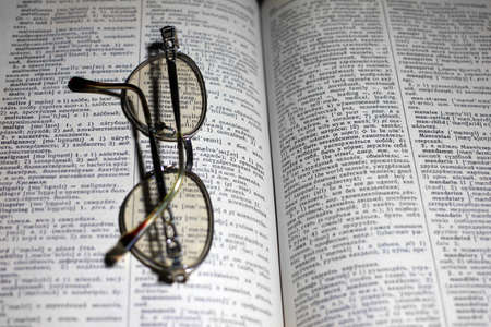 old book and glasses for the correction of sight photo
