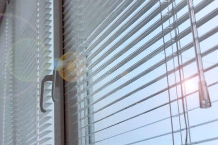 light plastic shutter on a window apartment Imagens
