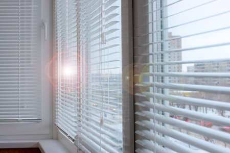 light plastic shutter on a window apartment Stock Photo