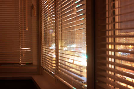 view through door: light plastic shutter on a window apartment Stock Photo
