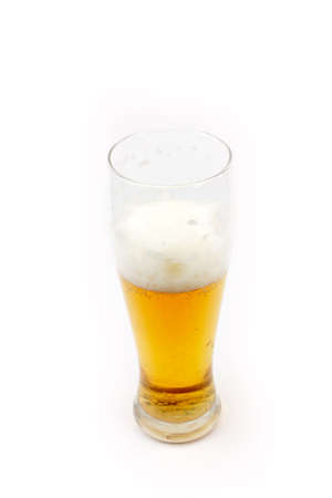 high glass with light beer stands on the table photo