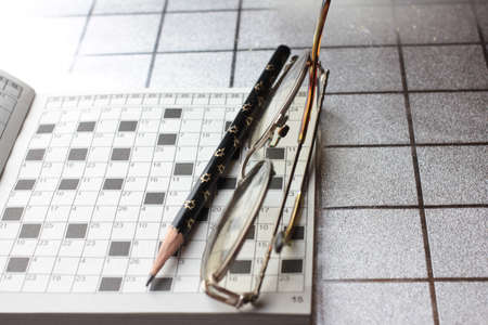 spectacles, pencil, crossword photo