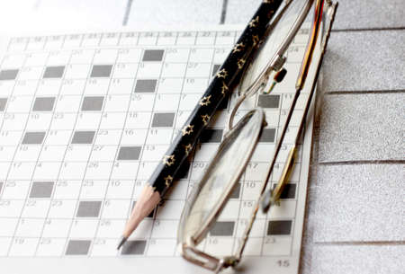 spectacles, pencil, crossword as drill of the thinking and logic photo