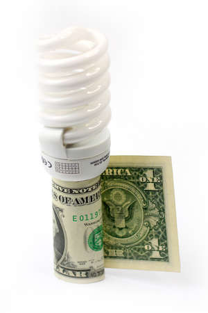saving energy lamp and paper bill dollar photo