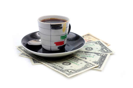 cup with strong black coffee and paper money dollars photo