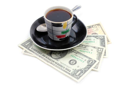 cup with strong black coffee and paper money dollars