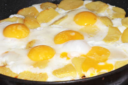 abstract preparation the fried eggs as element breakfast photo