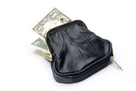 shallow paper dollars are in a black purse photo