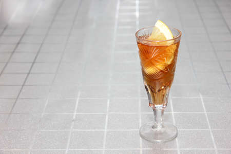 slice fresh lemon in wineglass with cognac Stock Photo