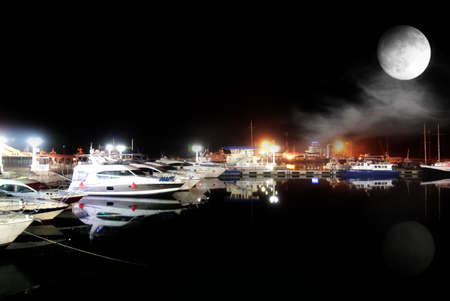 ship and yacht on quiet water in territory marine port photo
