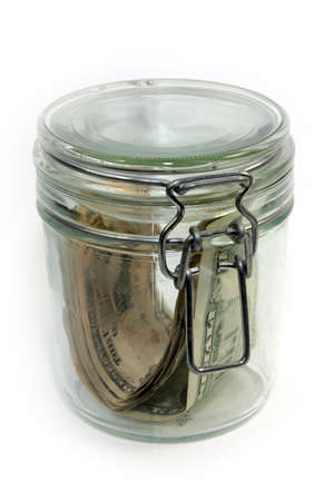 abstract image storage dollars in a glass jar photo