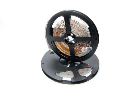 abstract led strip tape convolute on the plastic spool photo