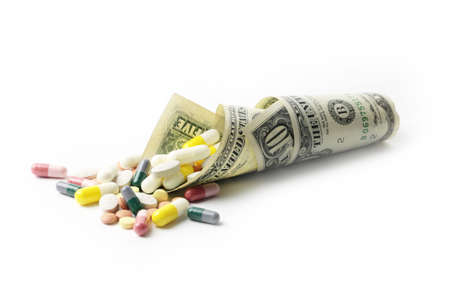 small heap of paper dollars fine and medicines photo
