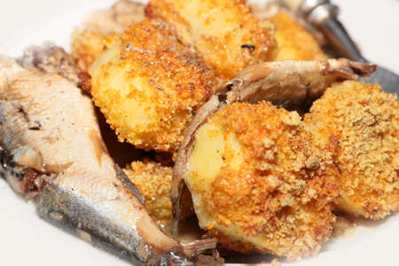 sprats: slices of smoked sprats canning and roasted potatoes