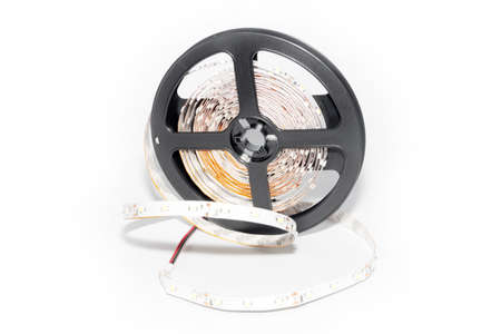 led lighting: Plastic reel with LED strips for lighting the room Stock Photo