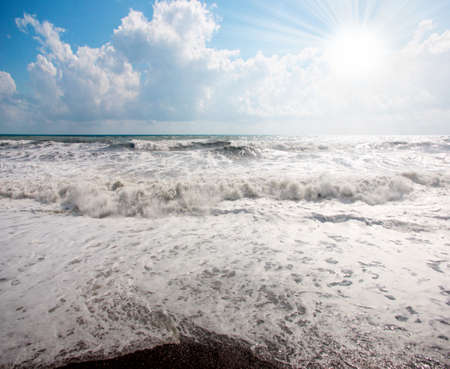 gale: High wave in time gale on a sea and blue sky Stock Photo