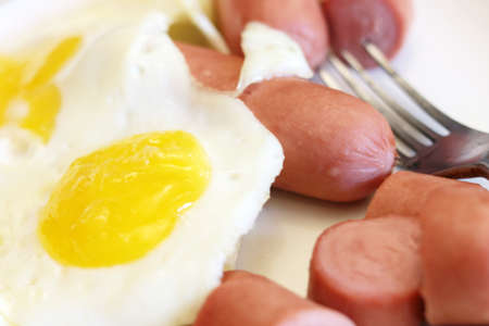 morning breakfast: Scrambled eggs and sausage as part of morning breakfast Stock Photo