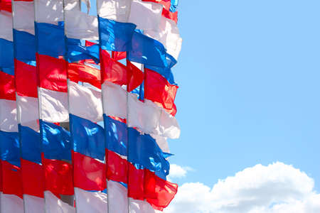 pennant in the colors of the Russian flag and the sunny sky photo