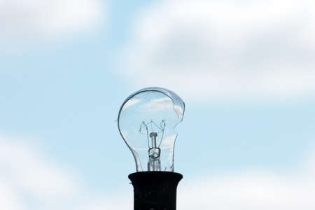 electric bulb: old broken electric bulb and sky Stock Photo