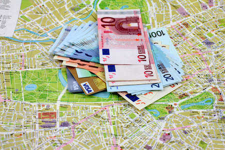 money euro: bank cards, paper money euro on the paper map