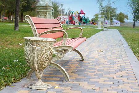 garden bench: Wooden garden bench in a city park Stock Photo