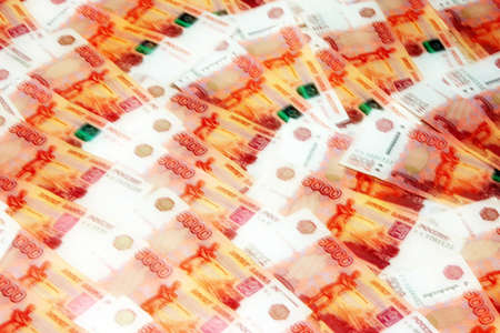 dividends: abstract background image of a Russian paper money