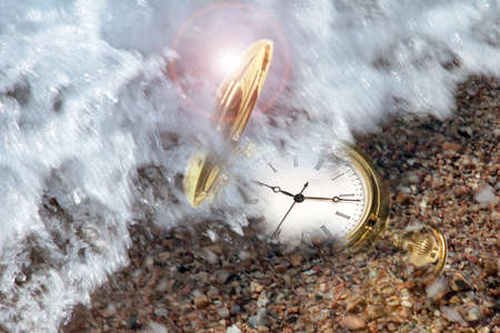 sand watch: gold watch and sand of the sea on the coast