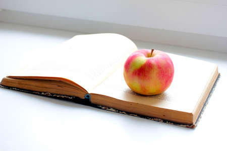 book pages: ripe apple and an open book pages