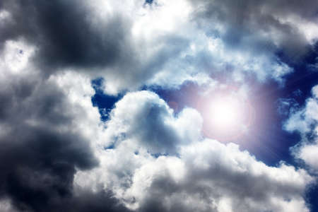 cumulus: dark stormy sky with clouds and bright sunlight Stock Photo