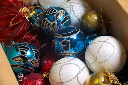 tree decorations: a box with colorful decorations for the Christmas tree