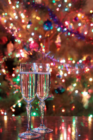 tall glass: tall glass of champagne on New Years festive table Stock Photo