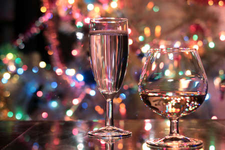 on duty: glasses of brandy and wine on festive background Stock Photo