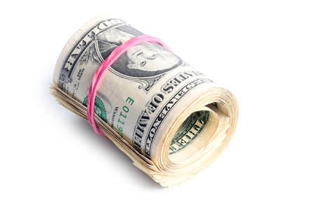 Paper small bills rolled into a tube dollars Stock Photo