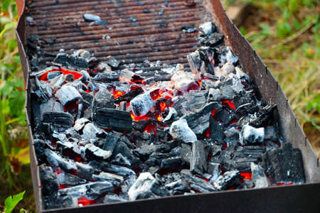 fuel and power generation: bright hot flame and glowing pieces of charcoal in the brazier Stock Photo