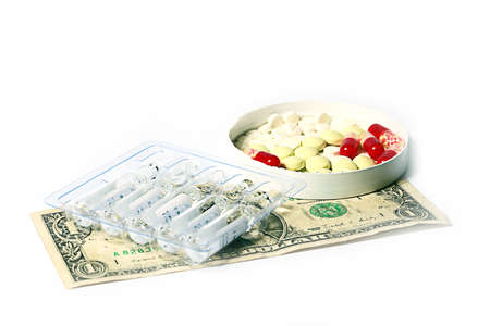 stack of dollar bill: pills, medical ampoules with medicine preparations and dollars