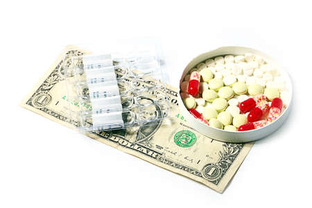 preparations: pills, medical ampoules with medicine preparations and dollars